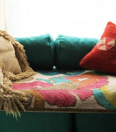 using a wool hooked rug as a cushion cover for your sofa (rug by Trina Turk via Justina Blakeney)