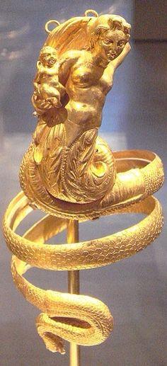 200 BCE Greek Gold Armband with a tritome, female mermaid deity, holding a putti.