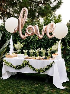 Bridal shower decor idea - The perfect statement piece for your next celebration. These 40 rose gold mylar balloon is easily strung and hung for your next party! (Looks great