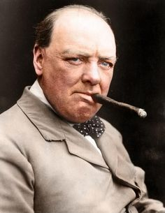 Winston Churchill, Prime Minister of England, enjoying his favorite past-time - Smoking a cigar :39 Historic Photos With Colour Added Are Incredible