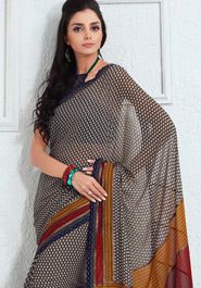 Simple and sober pattern grey shade saree with prints. Multicolored printed pallu gives it elegant look. Fancy lace adds charm. It will look good for evening parties. $40.00 http://goodbells.com/saree/printed-grey-saree-with-multicolor-pallu.html