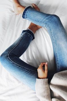Frayed jeans and cozy sweaters.