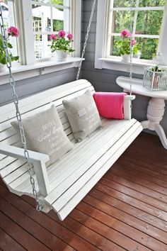 Sweet Southern Charm ⚓ This white porch swing looks so inviting. Where is the lemonade and my book? Outdoor Spaces, Outdoor Living, Outdoor Decor, Outdoor Swing Sets, White Porch, Porch Decorating, Interior Decorating, My Dream Home, Beautiful Homes
