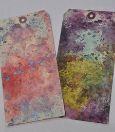 By Barbara Strembicki. At right: Distress Inks peeled paint, broken china, & dusty concord. Swipe pads on craft sheet close together but not overlapping. Spritz fairly well. Lay cardstock on ink; tap with fingers. Dry with heat tool. Pat same cardstock piece onto leftover ink ion craft sheet & dry with heat tool. Repeat patting & drying a second & perhaps a third time until you like the piece. At left, Perfect Pearls mist was sprayed on inks on craft sheet before spritzing with water. Video.