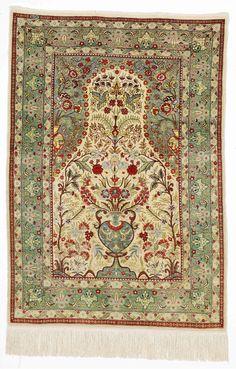 A signed full silk Hereke rug, Turkey. Classical niche design. Second half of the 20th century. C. 1 mio. kn. pr. sqm. 123 x 86 cm. Est. 2000-2400.- euro.