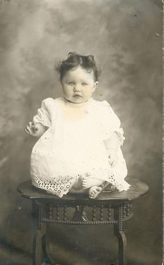 vintage baby how did they get him to sit there without falling over???