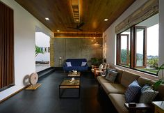 Wood and concrete for this living room of a house in Goa / Legno e cemento a vista per questa sala in una casa a Goa