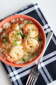 Paleo shrimp and grits — YES PLEASE! Cauliflower takes the place of grits in the traditional recipe for a tasty, low-carb alternative to the original.