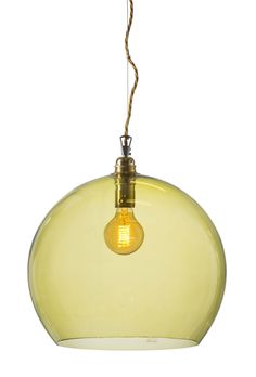 The Rowan pendant lamp is produced in mouthblown glass, combined with brass metal fitting and gold twisted fabric wire. The shade measures 39cm Ø.  Olive glass, 200cm wire www.houseofbk.com