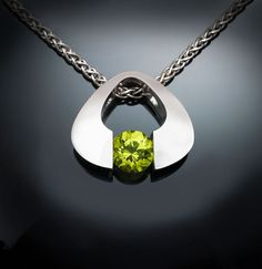 Argentium silver and peridot pendant designed by David Worcester for VerbenaPlaceJewelry.Etsy.com
