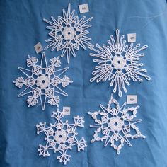 PDF Patterns for 5 Crocheted Snowflakes set 10 by TheNeedleWorksDo you like to crochet? Do you like giving gifts to friends and family that you have made yourself? You will enjoy trying these patterns out. These beautiful snowflakes make great decora Crochet Christmas Ornaments, Snowflake Ornaments, Christmas Snowflakes, Christmas Knitting, Christmas Crafts, Christmas Tag, Crochet Stars, Crochet Snowflakes, Crochet Motif