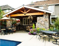 fireplace on the corner post rather than taking up a whole side.  http://www.houzz.com/photos/2467000/Outdoor-Living-craftsman-patio-seattle