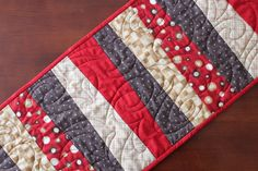 This fun modern strip quilted table runner was made by two friends who love to quilt together. We created the table runner with some of Deb