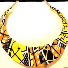 www.cewax.fr aime les bijoux ethno tendance Bijoux ethniques et style tribal. Retrouvez tous les articles sur la mode afro sur le blog de CéWax: cewax.wordpress.com/ Collier en tissu wax(pagne africain) couleur jaune et orange