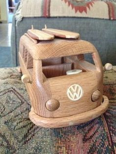 This is a vintage Volkswagen Bus with a surfboard on the roof. The bus is made from solid Oak. The surfboards are a combination redwood,oak, purple he… Vintage Volkswagen Bus, Volkswagen T1, Volkswagon Bug, Combi Wv, Vw Beach, Beetle Car, Bus Camper, Campers, Vw Cars