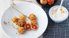 Breaded and fried sweet cherry tomatoes are a delicious vegetarian appetizer. Served with spicy and cool yogurt dip, they're ready in only 30 minutes.