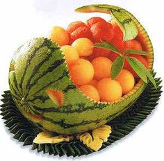 Perfect for a summer picnic, this Watermelon Fruit Basket is carved from a watermelon into the shape of a dolphin. Kids will love to help draw the pattern on the watermelon rind and make the melon balls with the help of a melon scoop. Refrigerate until serving time, when you can sit back and enjoy the compliments.  Find out how by pulling down the page at  http://asiarecipe.com/carving.html #vegan