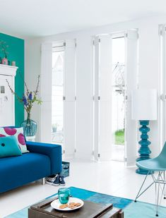 Blue Accents Pop in a White Room.  There is a DIY for the shutters on the site.