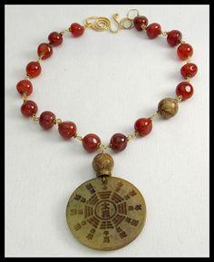 TIBETAN CALENDAR - Handcarved Jade Pendant - Hand Cut Carnelian Wirewrapped Necklace by sandrawebsterjewelry on Etsy