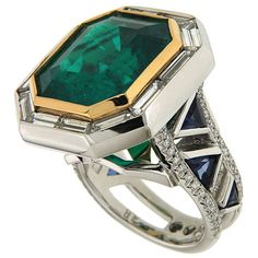 Rare 14.69 Carat Emerald Diamond Gold Ring with Triangle Sapphires | From a unique collection of vintage cocktail rings at https://www.1stdibs.com/jewelry/rings/cocktail-rings/