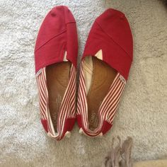 Tom shoes Lightly worn. Still great condition! Red at the top with red and cream stripes on the side! TOMS Shoes