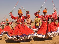Dancing, Desert Festival Jaisalmer, Rajasthan, India - February - Witness cultural events like camel races, and a moonlit concert. Want to get there? Take an SUV or camel safari. www.allabouttravel.org - www.facebook.com/AllAboutTravelInc - 605-339-8911