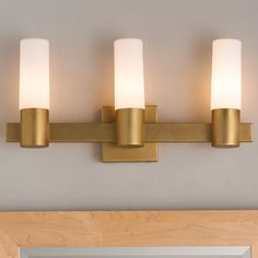 This Urban City Bath light is a transitional approach to the traditional bath light. Natural Aged brass with satin white cylinders combine with rectangular tubing to give this piece a contemporary design. Sconce Lighting, Vanity Lighting, Bar Lighting, House Lighting, Contemporary Bathroom Lighting, Contemporary Design, Modern Bathroom, Vanity Light Bar, Traditional Baths