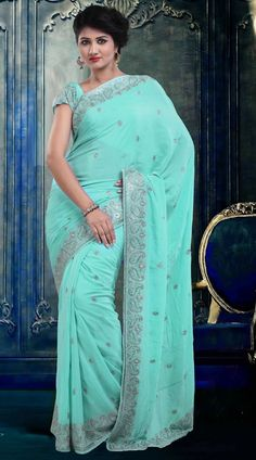 Fantastic Aqua Viscose Georgette Exclusive Saree With Blouse  ZP3004  Exclusive aqua viscose georgette saree which is ornamented with a stone and embroidery work all over. This outfit comes with matching blouse piece.The blouse of this saree can be stitched in the maximum bust size of 42 inches.