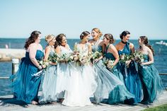 bridesmaids in blue dresses - photo by Cambria Grace Photography http://ruffledblog.com/italian-marbling-inspired-beach-wedding