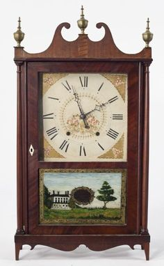 Seth Thomas Pillar and Scroll Shelf Clock first half 19th century, mahogany veneered case surmounted by brass urn finials, paper face with floral decoration, wooden works with pendulum, brass bob, weights and key.