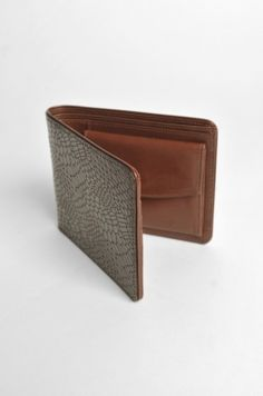 Wallet in croco style brown leather. Interior divisions, gold brand logo embossed.    100%Leather    color  Brown  price:£168.65