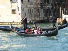 Gondoliers and Gondolas on the Grand Canal.