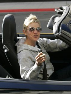 """Ellen DeGeneres Photos - Ellen Degeneres leaves the Beverly Wilshire Hotel in her Porsche. We get a glimpse into her """"Favs"""" on her iPhone. Wilshire Hotel, Beverly Wilshire, Ellen And Portia, Ellen Degeneres Show, Cool Inventions, The Beverly, Hollywood Celebrities, Actors, Lady"""