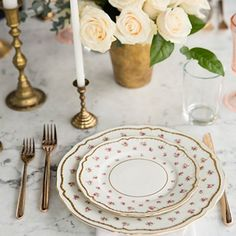 Vintage china and rose gold flatware make for a sweet and feminine tabletop.