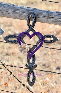 This beautiful horseshoe cross measures appox 16x12 with a heart in the middle. These feature a natural cross sealed and a distressed or shiny heart. The flower will be burlap in what is available at the time. It is made completely of new horseshoes. Each cross is handmade and may vary
