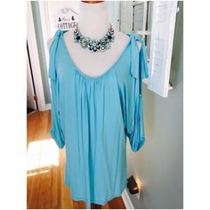 Turquoise beaded cold shoulder tunic This gorgeous tunic is in soft rayon/spandex and features sexy cold shoulders with tie detail at top, beautiful tiny beading around neck and armholes 3:4 dolman sleeves. Necklace available upon request Joyous & Free Tops Tunics