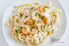 Love shrimp fettuccine alfredo but watching your weight? Try this creamy and delicious skinny version of everyone's favorite! Using just 1 tablespoon of butter and ½ cup of parmesan, this dish is simply amazing! Make sure to watch my video tutorial for step-by-step instructions!