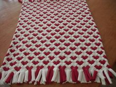 Red Heart rug made from recycled t shirts.