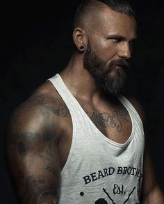 Big muscles, tattoos, that lovely beard, and those beautiful silver eyes. Delightful.