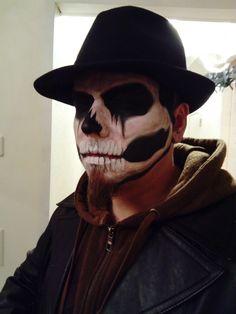 Skeleton makeup for men.