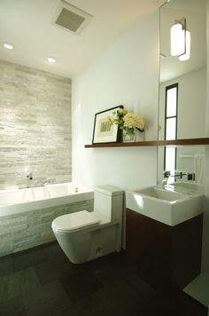 63 Sensational bathrooms with natural stone walls-Shelf that extends over sink and toilet