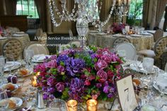 Fabulous purple and blue reception centerpiece with candelabras.