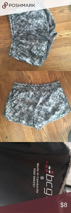 Athletic shorts Grey and black athletic shorts. Great condition. Worn 3 times BCG Shorts