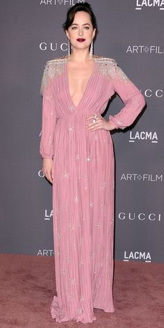 Look of the Day - Dakota Johnson from InStyle.com We can't get over Dakota Johnson at the 2017 LACMA Art + Film gala. The actress piled on the glamour with this crystal-emblazoned gown, featuring heavily decorated shoulders and a plunging neckline. Shimmering rings and drop earrings completed the look.