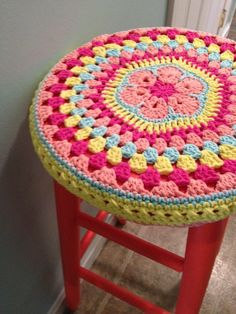 crochet african flower mandala stool cover and gladiola paint by sherwin williams. This was just an unfinished wood stool a few days ago Lots of other stool cover photos. Love the way crochet can interact with wooden furniture.inspiration no pattern Love Crochet, Crochet Granny, Crochet Motif, Beautiful Crochet, Diy Crochet, Crochet Crafts, Crochet Projects, Crochet Patterns, Crochet Ideas