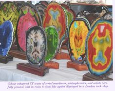 Color enhanced Ct scans of serial murderers, schizophrenics, and artists carefully printed, cast in resin to like like agates displayed in a London rock shop.
