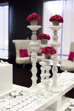Elegant white and pink wedding decor table centerpieces, candles, candle holders