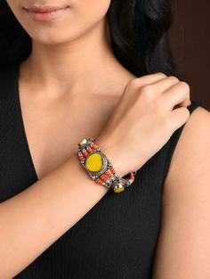 Buy The Stone Age Parampara Elevate your look with spectacular silver-tone stone-beaded jewelry for over-the-top statement Online at Jaypore.com Bangle Bracelets, Bracelet Watch, Bangles, Shopping Coupons, Backpack Brands, Stone Age, Orange, Yellow, Beaded Jewelry