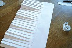 Tape pleats to brim.