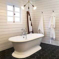 Amazing bath by @andreaseglarsson of HabHaus in Los Angeles using our Pacific Black Hex. ・・・ Who's ready for a bath? Very pleased how this master bath turned out.  #habhouse. .............. #myonepiece #bathroomporn #tileaddiction #castirontub #designbuild #cementtileshop #cementtiles #cementtile #concretetile #hydraulictiles #hexagon #hextile #hex #handmadetiles #handmadetile #patternedtile #encausticcementtile #encaustictiles #shiplap